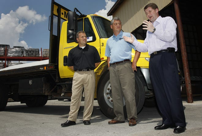 On Nov. 5, 2018, Meek's Lumber Company announced it was closing six southern Missouri stores, including its store on East Sunshine Street in Springfield. In this 2009 photo, Matt Morrow, then an official with the Home Builders Association of Greater Springfield (right), joined Charles Meek, General Manager of Meek's Lumber Company )(center) and Sam Clifton, Owner of Millstone Custom Homes (left) at a press conference.
