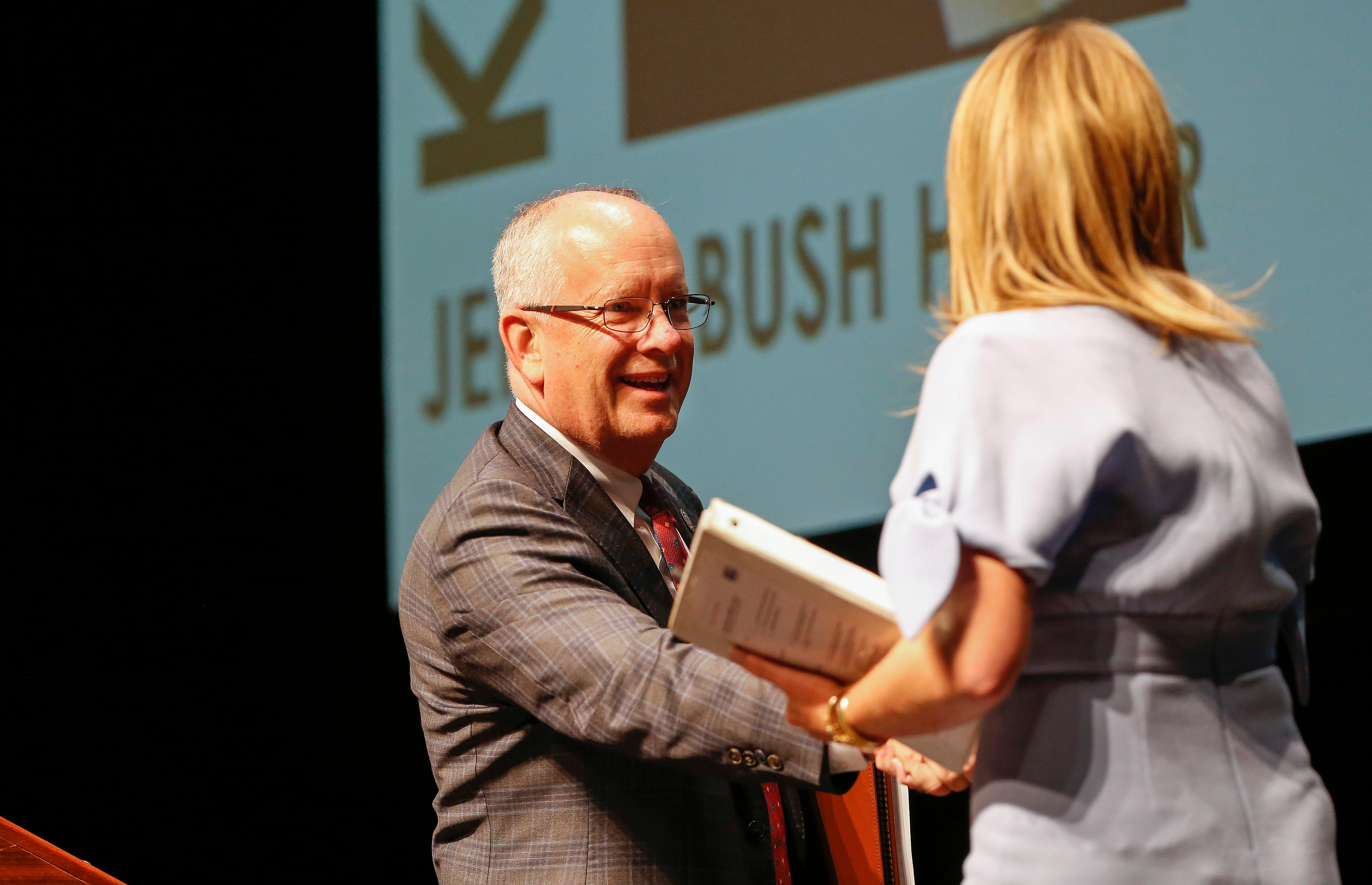 Missouri State University President Clif Smart shakes hands with Jenna Bush Hager who presented the keynote speech during the Public Affairs Conference at the Juanita K. Hammons Hall for the Performing Arts on Tuesday, Sep. 25, 2018.