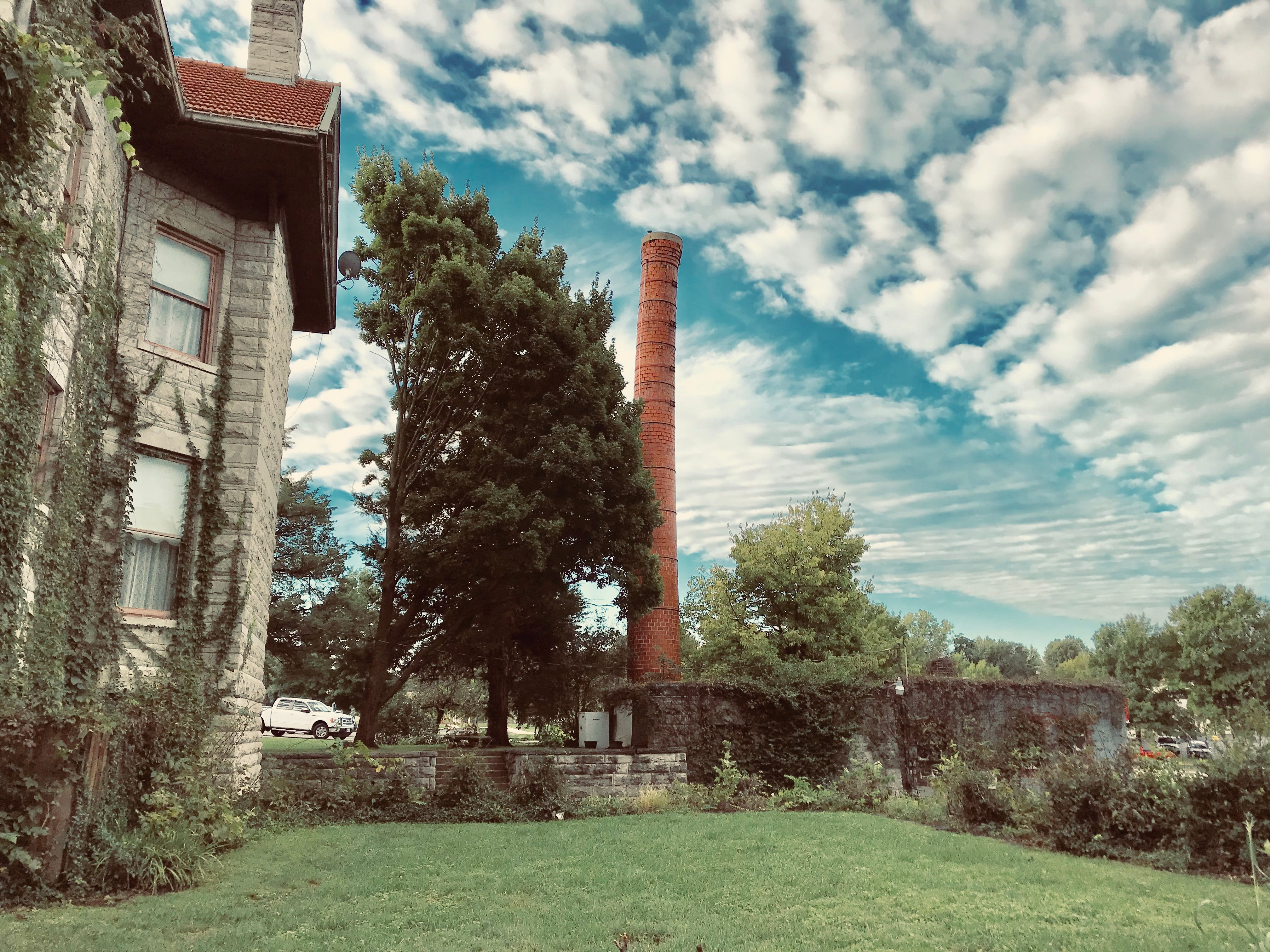 The chimney at the Elfindale Mansion was built as part of the original power plant for the building back in 1892.  The mansion was heated by steam that was piped to radiators.  Yes, it's crooked.