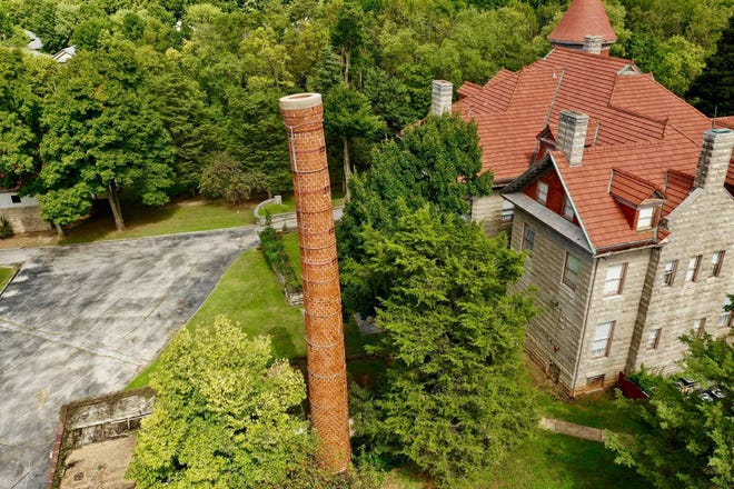 This drone photo of Elfindale Mansion shows the large smokestack that was once part of the boiler room.  Yes, it is leaning.