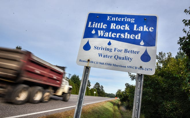 Traffic moves past a sign announcing the Little Rock Lake Watershed along the north shore of Little Rock Lake Wednesday, Sept. 26, near Rice.