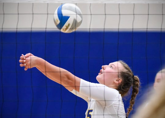 Cathedral's Gabby Heying bumps the ball to a teammate against Becker's during the second game Tuesday, Sept. 25, in Becker.