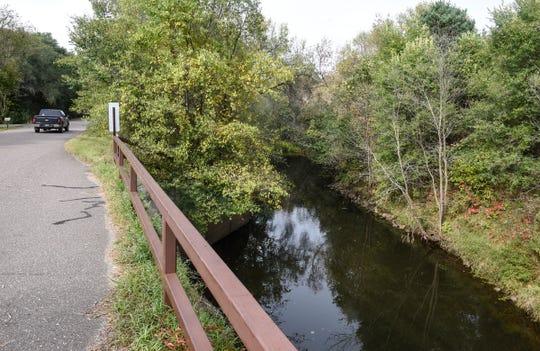 Little Rock Creek flows under a bridge Wednesday, Sept. 26, near Rice.