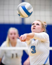 Becker's Abby Maruska bumps the ball to a teammate against Cathedral during the second game Tuesday, Sept. 25, in Becker.
