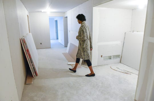 CeCe Terlouw, executive director of Terebinth Refuge, tours the construction progress Wednesday, Sept. 26, at the shelter. The space will add four bedrooms with room for two people in each room.