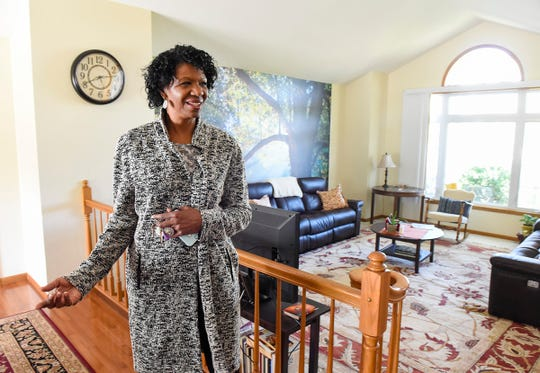 CeCe Terlouw, executive director of Terebinth Refuge, shows the finished living room Wednesday, Sept. 26, at the shelter, which is a safe place for victims of sex trafficking. Construction is underway to complete the lower level and add space for eight more people.