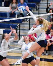 Becker's Payton Anderson spikes the ball over the net against Cathedral during the first game Tuesday, Sept. 25, in Becker.