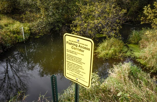 Signs guide anglers on Little Rock Creek Wednesday, Sept. 26, near Rice.