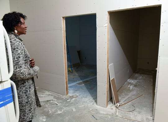 CeCe Terlouw, executive director of Terebinth Refuge, checks construction progress Wednesday, Sept. 26, on the garage being finished to create two offices at the shelter.