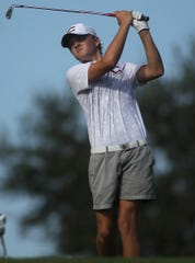 Chiles freshman Parker Bell watches a tee shot during the Big Bend Championships at Southwood Golf Club. Bell won in a one-hole playoff after shooting 68.