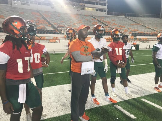 FAMU head coach Willie Simmons calls in the plays during practice.