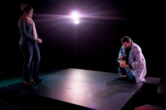 """Glory (Caroline Nieves) and East (Nathan Williamson) pick up the pieces in """"Her Heart,"""" part of """"Almost Maine"""" at Theatre Tallahassee."""
