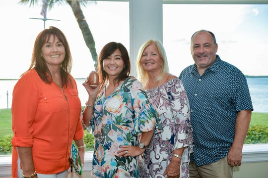 Palm City residents Tara Edwards, left, Paula Ludwig, Cindy McKeon and Michael Low, supporters of Voices for Children of Okeechobee and the Treasure Coast.
