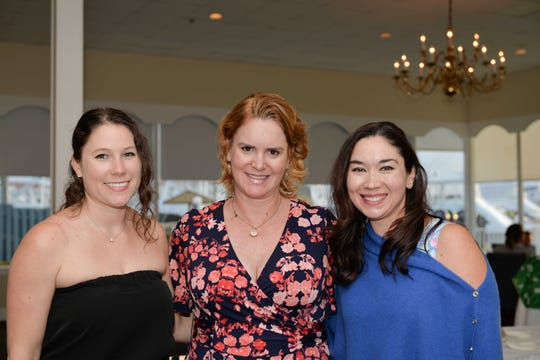 Taylor Hoskins, left, Donna DeMarchi and Sara Davis at the Pelican Yacht Club for the kickoff party for the Ultimate Tailgate Party.