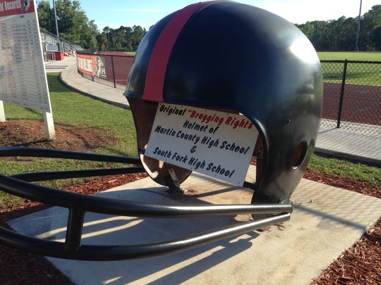 The original Martin Bowl helmet sits outside Joebud Staggs/Bulldog Stadium at South Fork. For years, the helmet was painted in the winning team's colors and displayed at two locations in Stuart.
