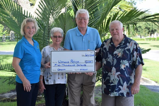 Women's Refuge of Vero Beach Executive Director Diane Ludwig, left, accepts a $5,000 grant from Christ Church Outreach Committee members Susan Steinbach, Brian Van Nest and Richard Steinbach.