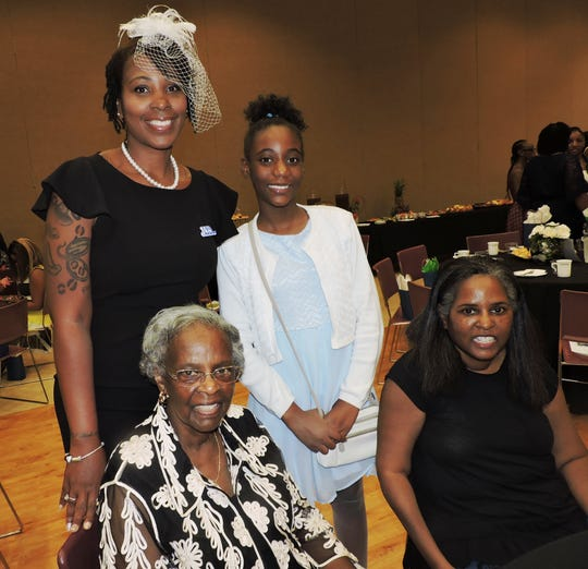 Chapter organizer Arlena Lee, seated, daughter Arlena D. Lee, standing, Lashonda Henderson and goddaughter Kijda Hardy attended the Mother & Daughter Tea at the Port St. Lucie Civic Center.