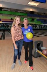 Little Sister Callan with Big Sister Diamond Litty at the 30th annual Bowl for Kids' Sake.