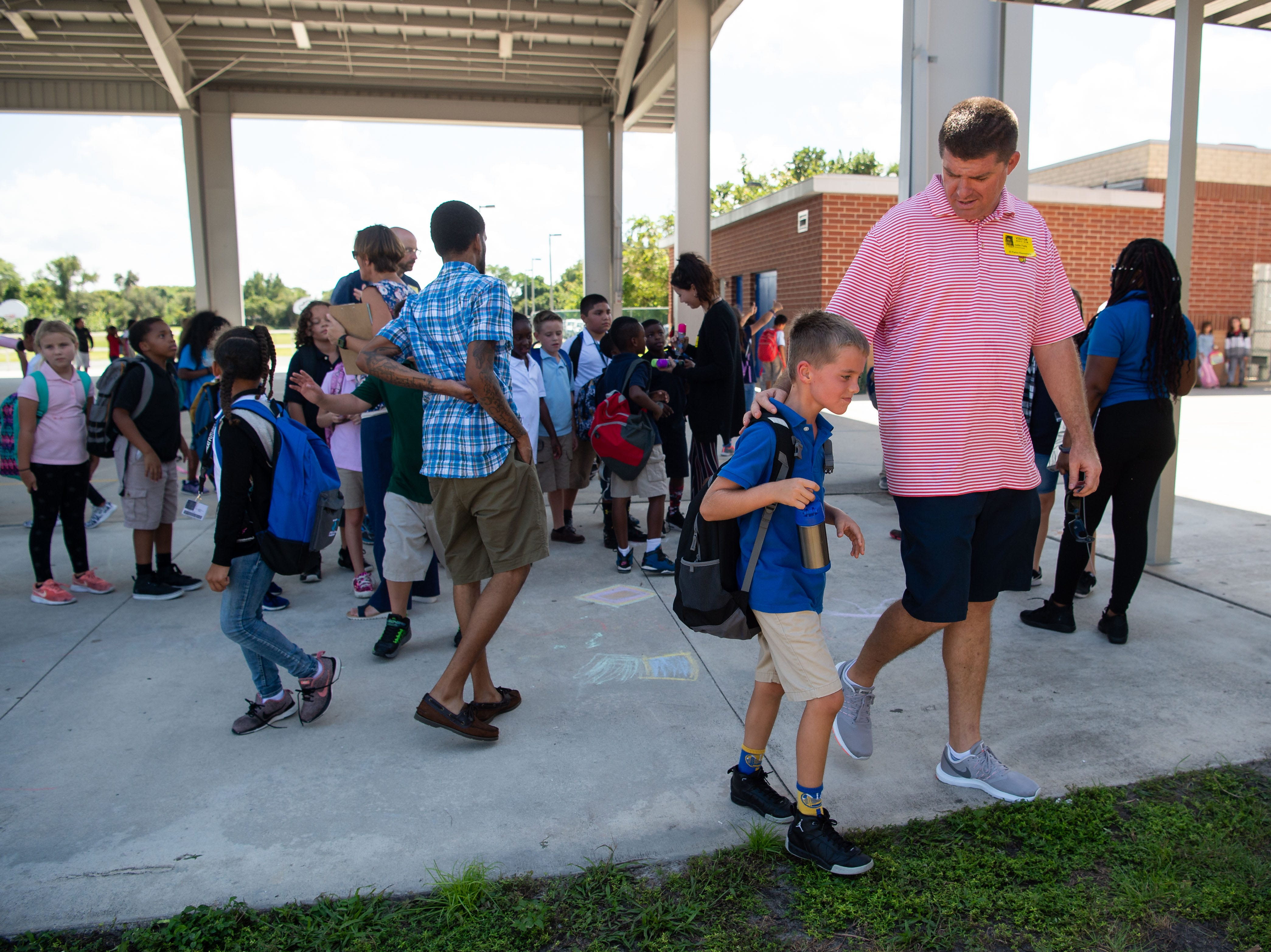 "J. D. Parker School of Science, Math and Technology hosts their ""Dudes Day"" event, coinciding with the Florida Department of Education's ""Dads Take Your Child to School Day,"" on Wednesday, Sept. 26, 2018, at the school in East Stuart. Fathers, stepfathers, grandfathers, uncles, brothers, foster fathers and other male role models were invited to take their children to school, according to the statewide initiative, to support children by providing positive male role models."