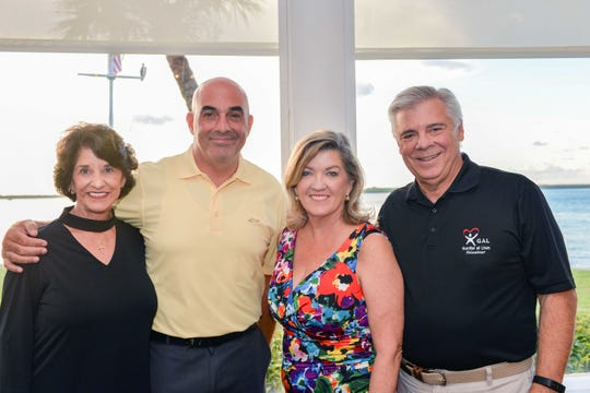 Ultimate Tailgate Party Sponsors Kay and Chris Rodriguez, left, of Lang Realty with Jane and Bob Perry.