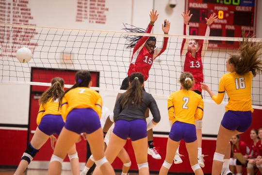 Vero Beach's Destiny Nelson (center) and Aubrey Schlitt jump up to block as Fort Pierce Central's Brenna Tietz (far right) tries to spike in the second game during the high school volleyball match Tuesday, Sept. 25, 2018, at Vero Beach High School.
