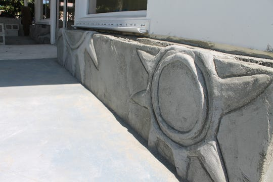 Detail of early stages of exterior concrete work in the front of the building.
