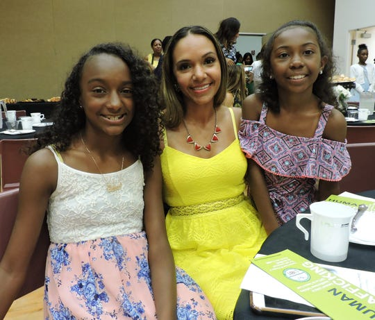 Leidys Lorenzo, center, with daughters Jailyn Lorenzo, left, and Zenaiya Francis at the Mother & Daughter Tea sponsored by Links, Incorporated.