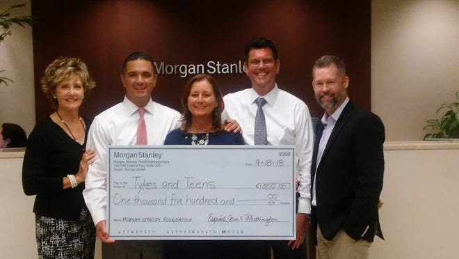 Tykes & Teens representatives Paula Hundt and Jeff Shearer recently accepted a $1,500 donation from Espinal, Stern & Whittington on behalf of the Morgan Stanley Foundation. Pictured are, from left, Hundt, Rene Espinal, Sue Whittington, James Stern and Shearer.