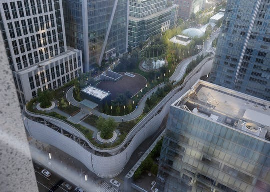 The Salesforce Transit Center complex, stretching several blocks, is seen after its closure Tuesday in San Francisco. San Francisco officials shut down the city's celebrated new $2.2 billion transit terminal Tuesday after discovering a crack in a support beam under the center's public roof garden.