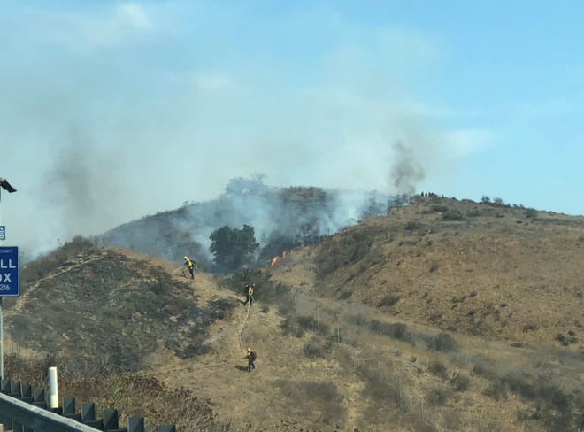 Crews were working to put out a series of spot fires Wednesday on the south side of Highway 118 in Moorpark.