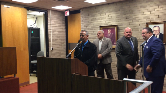 Vineland police Chief Rudy Beu, at the podium, spoke at a retirement presentation for former police Capt. Matthew Finley at City Council Tuesday night. Left to right behind Beu are Public safety Director Edwin Alicea, Finley, and Mayor Anthony Fanucci.