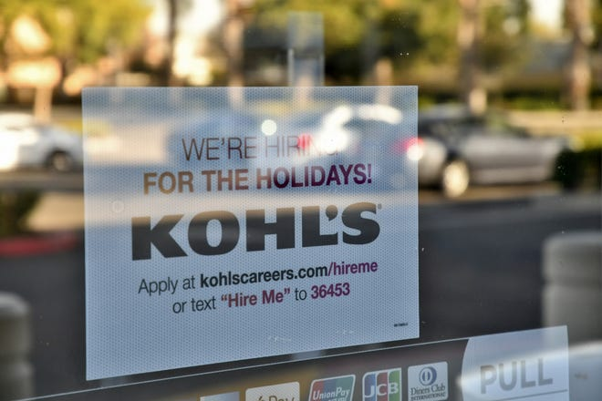 A sign on an entrance door alerts potential employees to seasonal openings at Kohl's on Mooney Boulevard in Visalia on Wednesday, September 26, 2018.