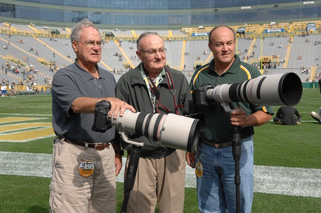Photographer Vernon Biever, center, started a lifelong career with the Packers in 1946. His sons, John, left, and Jim, right, followed his lead.
