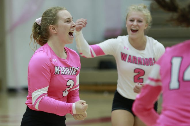 Wausau West's Jenna Rusch left, and teammate Skylar Rickstad celebrate a point against Wausau East on Tuesday during the Volley for the Cure girls volleyball game at Wausau East High School.