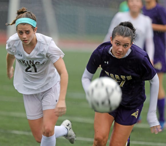 Clarkstown North's Jessica Reck (27) and Clarkstown South's Liz Levine (21) battle for control of the ball during girls soccer game at Clarkstown North High School in New City on Sept.25, 2018. Clarkstown North defeats Clarkstown South 1-0.