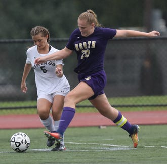 Clarkstown North's Jane Mulvey (20) and Clarkstown South's Gianna Cinque (5) battle for control of the ball during girls soccer game at Clarkstown North High School in New City on Sept.25, 2018. Clarkstown North defeats Clarkstown South 1-0.