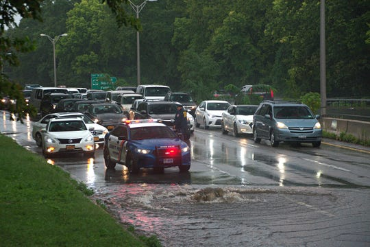 Cars travel through the flooded Bronx River Parkway in Yonkers on Sept. 25, 2018.