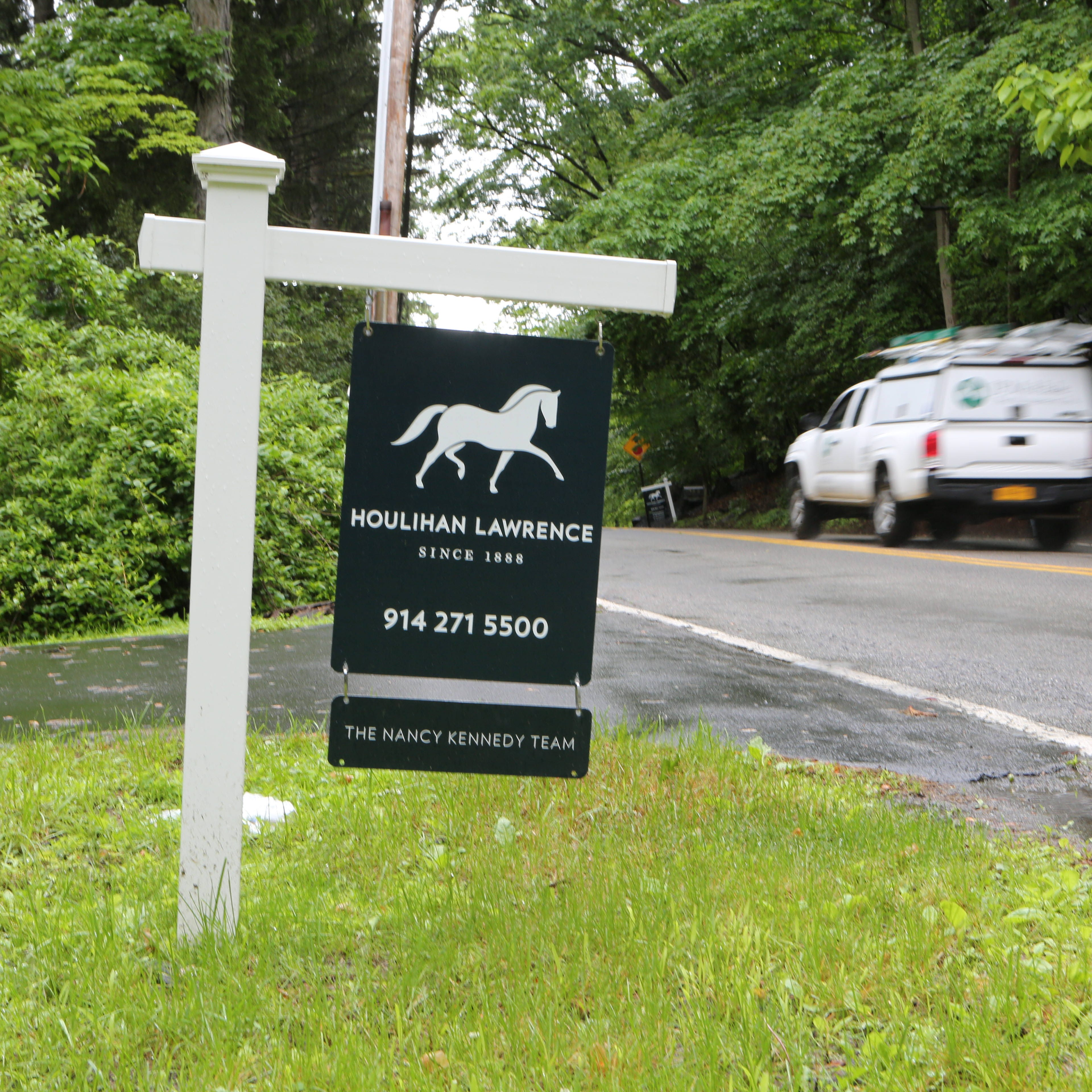 A home for sale sign along Washington Street in Cortlandt, June 6, 2017.