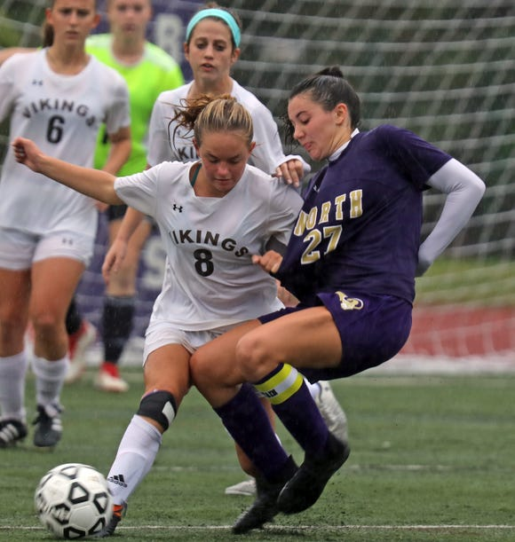Clarkstown North's Jessica Reck (27) and Clarkstown South's Corinne Kelly (8) battle for control of the ball during girls soccer game at Clarkstown North High School in New City on Sept.25, 2018. Clarkstown North defeats Clarkstown South 1-0.