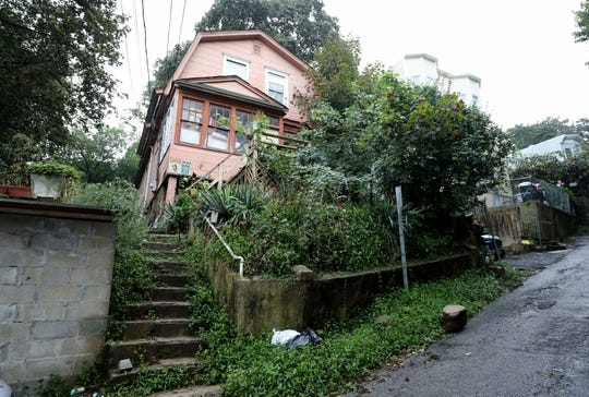 This home at 49 Currans Lane in Yonkers, pictured Sept. 26, 2018, cost the city $7,975.03 to clean up this neglected property.