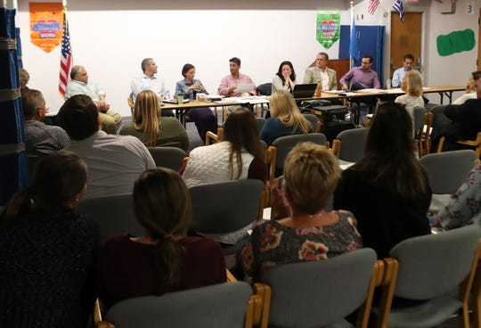 Odyssey Charter School board members meet Tuesday at the Barley Mill Plaza school.