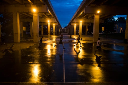 People play basketball on the Adams Street Courts underneath I-95 in Wilmington.