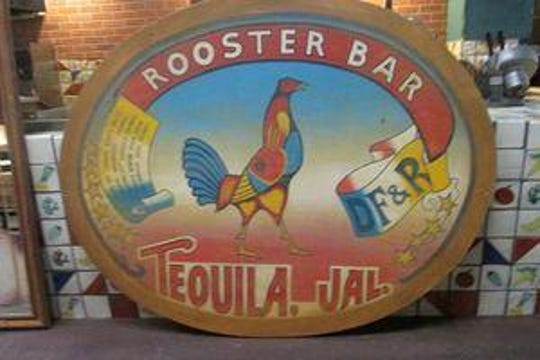 An oval wooden rooster bar sign is one of the many items being auctioned online from the Don Pablo's Mexican Kitchen restaurant that closed on Sunday near the Christiana Mall.