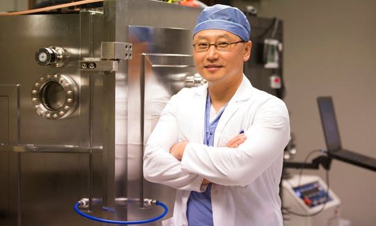 """Dr. Kendall Lee, co-principal investigator and director of Mayo Clinic Neural Engineering Laboratories, poses for a portrait at the clinic in Rochester, Minn. on Sept. 18, 2018. Lee, who treated Jered Chinnock said that the study involving electrical implants, """"gives hope to people who are faced with paralysis that functional control may be possible."""" (AP Photo/Teresa Crawford)"""