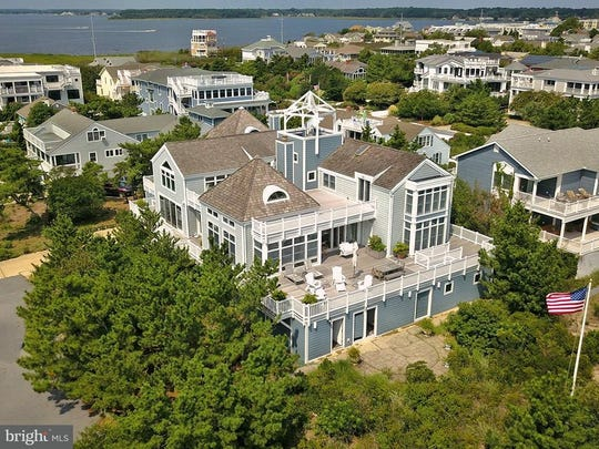 For $4,900,000, you get six bedrooms, four full bathrooms with two half baths, 8,399 square feet on a 0.34-acre lot at 1 Hazlett Ave. in Rehoboth Beach.