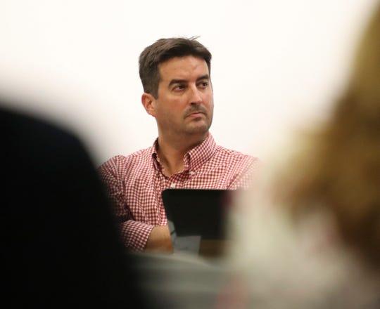 Odyssey Charter School board president Josiah Wolcott listens during the school's board of directors meeting in September 2018.