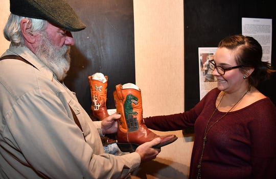 Wichita County archivist Bill Steward shows Madeleine Calcote, executive director of the Museum of North Texas, a pair of custom boots he had made by Mike Spikes of Henrietta. They are part of the exhibit, Boots On North Texas.