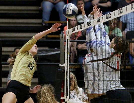 Rider's Meredith Fisher is blocked by Abilene Cooper Tuesday, Sept. 25, 2018, at Rider. The Lady Raiders defeated the Cougars 25-17, 25-12, 25-13 in the district opener.