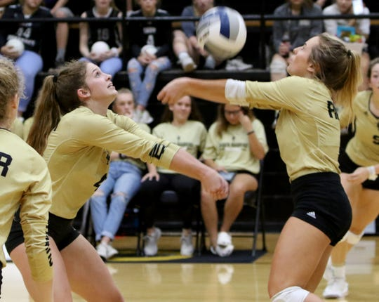 Rider's Anna Grace Beasher, left, and Devon Browning go for the ball in the match against Abilene Cooper Tuesday, Sept. 25, 2018, at Rider. The Lady Raiders defeated the Cougars 25-17, 25-12, 25-13 in the district opener.