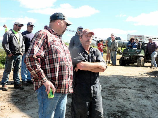 A lot of serious conversation takes place at a farm auction.